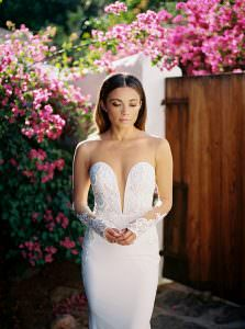 lifestyle influencer Valerie Star on her wedding day wearing a plunging neckline wedding dress from Berta Bridal at wedding venue Korakia Pensione, Palm Springs captured by los angeles wedding photographer Dennis Roy Coronel photography